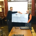 Cliff Ivers MAS Treasurer receiving the cheque from Rotary Member Audrey Riches